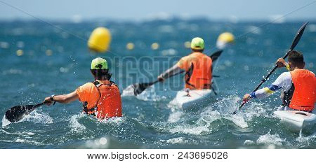 Paddlers Race Their Ocean Kayak