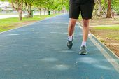 Running Feet Male In Runner Jogging Exercise With Old Shoes For Health Lose Weight Concept On Track  poster