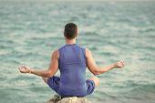 Mens Heals Body Care. Yogi Having Meditation At Beach. Health And Fitness Concept. Boy Practicing Yo poster