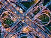 Top View Of Highway Road Junctions At Night. The Intersecting Freeway Road Overpass The Eastern Oute poster