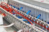 Electrical Wires Or Cables Are Laid In A Perforated Protective Channel. The Wires Are Connected To E poster