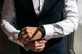 A Man In A Business Suit Zips Up Shirt Cuffs. Cropped Image poster