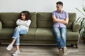 Frustrated Millennial Couple Sit Apart On Couch In Living Room Not Talking After Fight, Unhappy Boyf poster