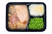 stock photo of frozen tv dinner  - A TV dinner consisting of turkey ham peas and mashed potatoes isolated on white - JPG