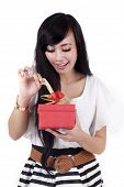 Attractive Woman Open A Gift