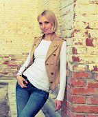 woman at the brick wall