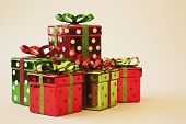 stock photo of poka dot  - images of 5 shiny poka dotted christmas boxes - JPG