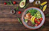 Delicious Healthy Buddha Bowl With Shrimps, Tomato, Avocado, Quinoa, Lemon And Arugula On The Wooden poster