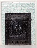 Antique Cast Iron Furnace And Tiled Wall