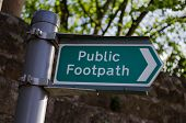 A Clean And Clear Metal Signpost Giving The Direction Of A Public Footpath. poster