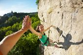 The Girl Climbs The Rock On The Background Of A Forest Landscape. Fitness In Nature. The Woman Gives poster