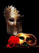 stock photo of mardi gras mask  - Masquerade masks painted with lig on a black background - JPG