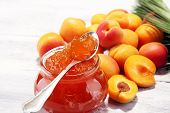 Apricot Jam And A Bunch Of Fresh Apricots On Wooden Table. poster