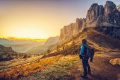 Traveler Hiking Breathtaking Landscape Of Dolomite poster