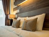 Empty Double Bed And Lamp On Side Of Bed In Luxury And Natural Style Bedroom Is Decorated With Woode poster