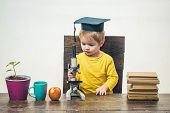 Kid Boy With Microscope. Smart Small Boy, Scientist Child In Academic Cap Works With Microscope. Ear poster