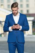 Message Concept. Man In Suit Businessman Takes Advantages Of Modern Mobile Technologies. Man Reads M poster