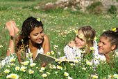 stock photo of teenage girl  - group of pretty teenagers reading book or bible - JPG