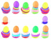 Twelve Easter Eggs In Multicolored Fluffy Clutches
