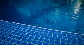 Clean Blue Water Of The Swimming Pool, Nobody. Swimming Pool Background. poster