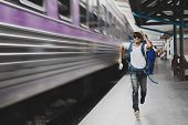 Tourist With Bag Running Behind The Train, A Man Runs For A Moving Wagon, Backpacker Hurries For Tra poster