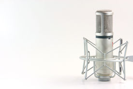 stock photo of recording studio  - isolated recording microphone with blank space on the left side for message music concepts horizontal - JPG