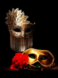 foto of mardi gras mask  - Masquerade masks painted with lig on a black background - JPG