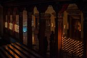 Solemn Evening Ritual Of Ignition Of Oil Candles In Temple Of The Tibetan Buddhism Lineage. poster