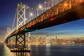 Western Span Of San Francisco-oakland Bay Bridge And San Francisco Waterfront In Blue Hour. Shot Fro poster