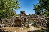Building Ruins With Arched Entrance. Beautiful Warm Spring Day And Archeological Ruins At Butrint Na poster