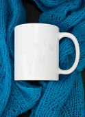 White Coffee Mug Mockup With A Knit Blue Lace Scarf.  Room For Text Or Art On This Coffee Cup For Mu poster