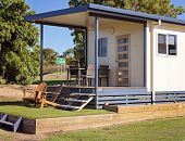 A Typical Australian Country Caravan Park Cabin Accommodation For Overnight Or Weekly Stays poster