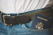 American Passport In Jeans Pocket. The Young Man Is Preparing For The Journey. Waiting For A Flight  poster
