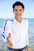 Cheerful Guy Posing Outdoors. Young Man Making Welcome Inviting Hand Sign Gesture Or Giving Palm For poster