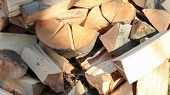 A Neatly Folded Log Of Chopped Wood. The Fire Is Melting. Firewood Stacked On Top Of Each Other. Fir poster
