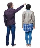 Back view of couple couple in winter jackets pointing. beautiful friendly girl and guy together. Rea poster