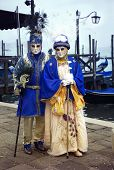 Couple In Carnival Costumes Posing At The Venetian Lagoon During The Days Of Carnival In Venice poster