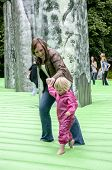 A mother and child walk on the life-sized inflatable replica of Stonehenge