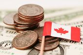 Canada Flag With Coins On Dollar Banknotes Background :  Banking Account, Investment Analytic Resear poster