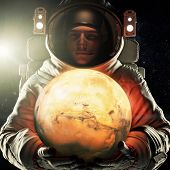 Astronaut Holding The Red Planet Of Mars. Exploration And Journey To Mars Concept. 3d Rendering .ele poster