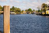 A Shot Of A River With A Wooden Pole In The Foreground In Florida poster