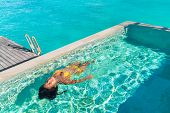 Luxury resort swimming pool fun travel summer holiday sexy bikini woman enjoying water of Tahiti res poster