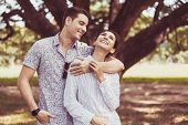 Couple Young Teen In Love Hugging Together At Park,romantic And Enjoying In Moment Of Happiness Time poster