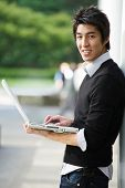 Asian Student With Laptop