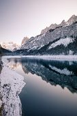 Gosau Lake In Winter With Fresh Snow On Majestic Mountains, Pines Forest And Reflection On The Lake poster