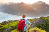 Hiking man in Canadian mountains. Hike is the popular recreation activity in North America. There ar poster