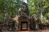 Ancient Ruins Of Ta Som Temple In Angkor Wat Complex, Cambodia. Stone Temple Ruin With Jungle Tree A poster