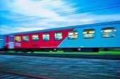 a passenger train travels through the night. night train with people of the �?�?�?�¶bb