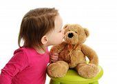 Little Toddler Girl Kissing A Teddy Bear