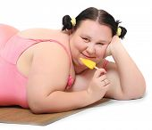Overweight woman with sweet ice lolly. Unhealthy lifestyle concept.